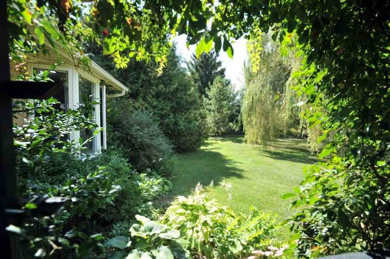 Property backs onto a ravine with a farm to the East