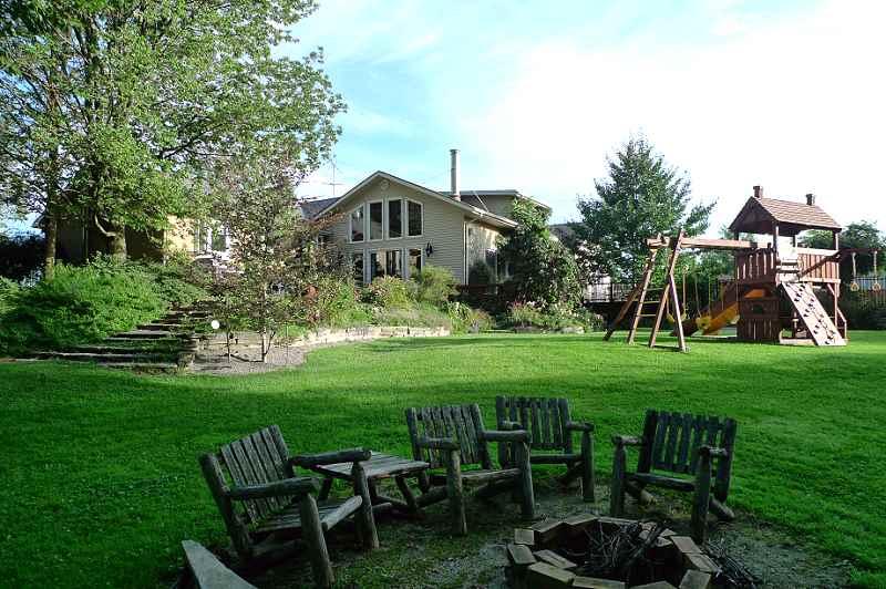 Perennial gardens, flagstone patio & walkways, firepit
