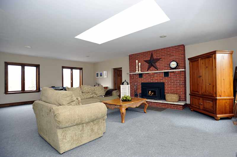 Upstairs Second Family Room - Pacific Energy wood-burning fireplace, a skylight & broadloom