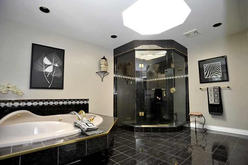6-piece ensuite - large glass double shower w/ steam sauna feature, jacuzzi tub, double sinks, skylight