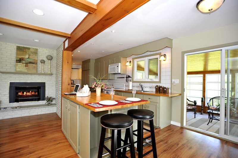 Gourmet Kitchen - ceramic flooring & backsplash, centre island, large built-in stainless Kitchen-Aid fridge, built-in dishwasher, stove, microwave, pot lights