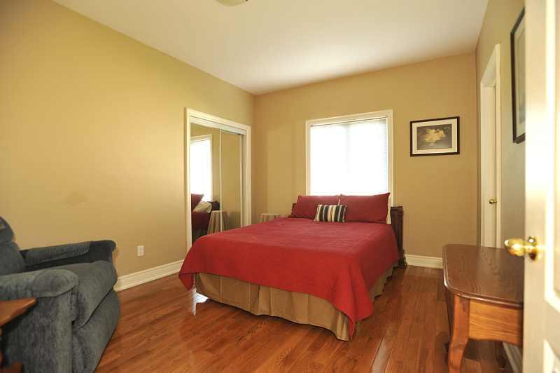 bedroom - hardwood flooring, mirrored door closet & and semi-ensuite bathroom