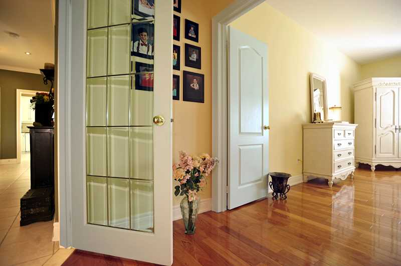 Bedroom wing has a French door entry