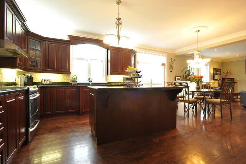 slate backsplash, pantry, crown mouldings and hardwood flooring