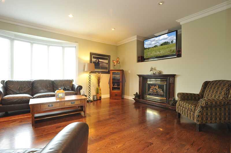 Great Room - propane gas fireplace, oak hardwood, pot lights, crown mouldings, open concept