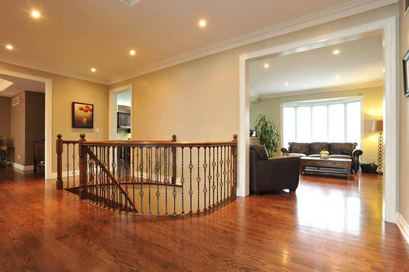Entrance - oak hardwood, pot lights & crown mouldings