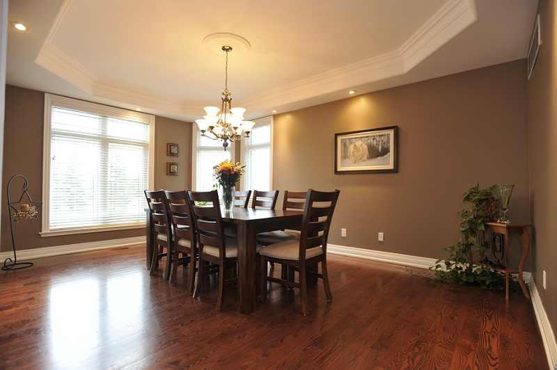 coffered ceilings, crown mouldings, pot lights, hardwood flooring