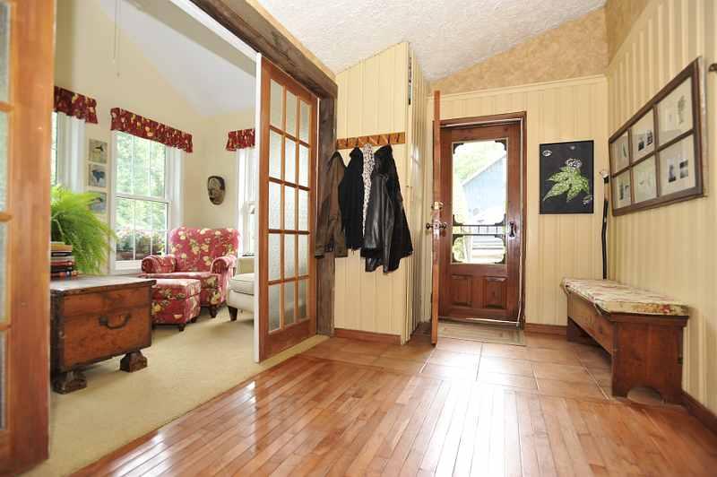 Foyer has ceramic and original maple flooring