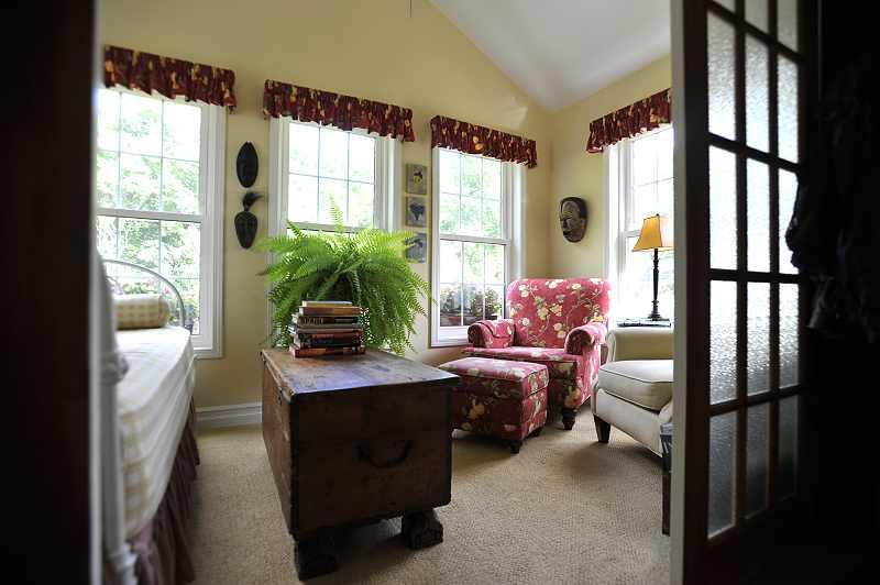 Sunroom carpeted, overlooks the backyard