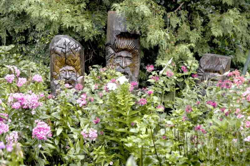 surrounded by cedars and flowering plants