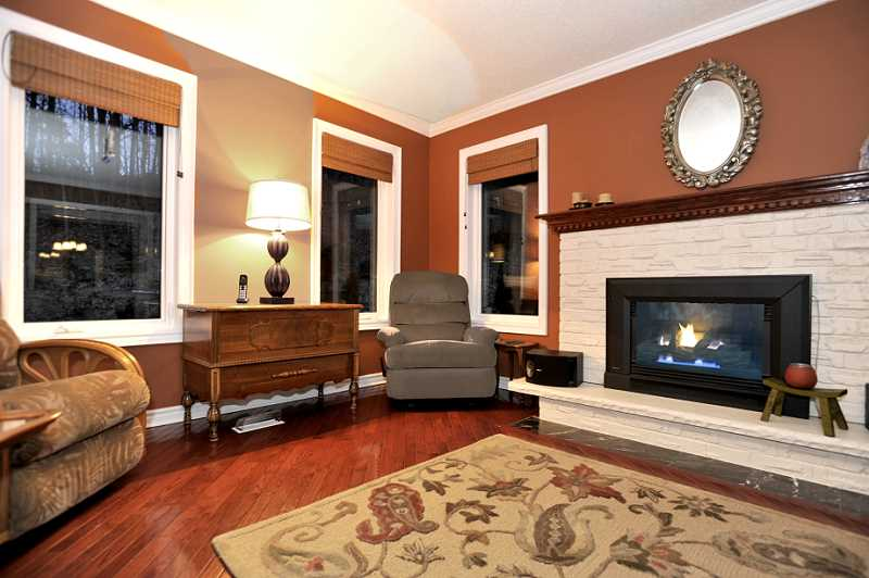 Family Room, New Vinyl Windows, Gas Fireplace, Hardwood