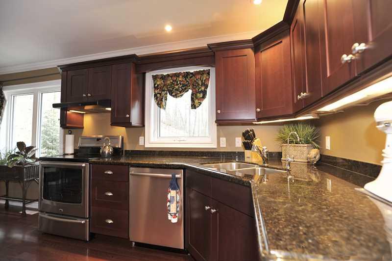granite countertops, under-counter lighting, pot drawers, pot lighting