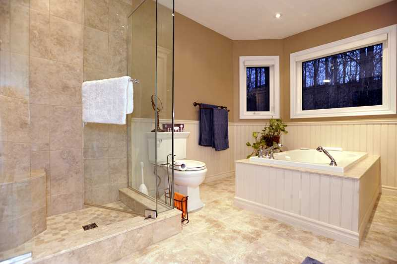 newly renovated 4-piece ensuite with wainscoting, pot lighting, quartz counters