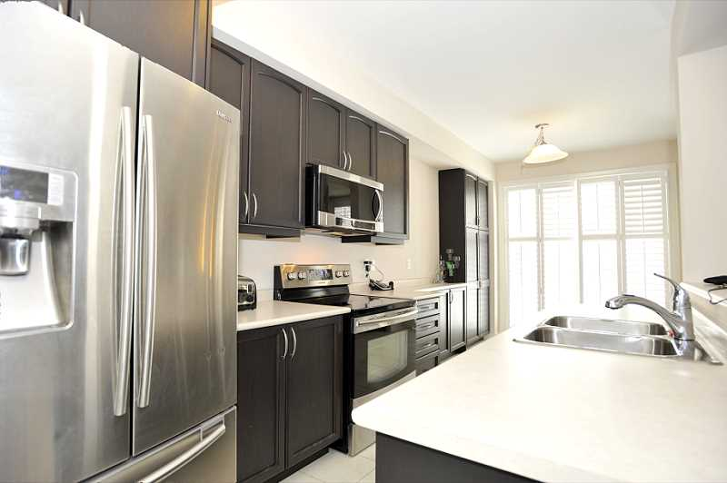 Dark Oak Kitchen w/ Stainless Steel Appliances