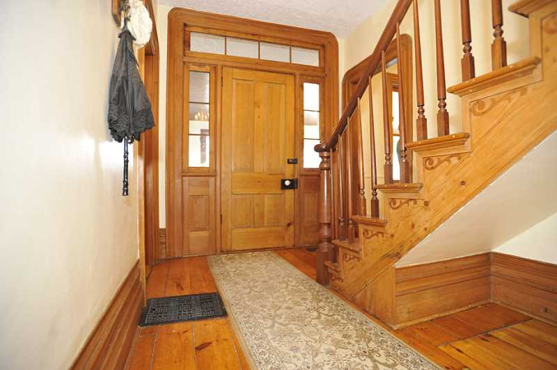 high baseboards, cherry bannister, solid doors, rounded window mouldings, original plank flooring