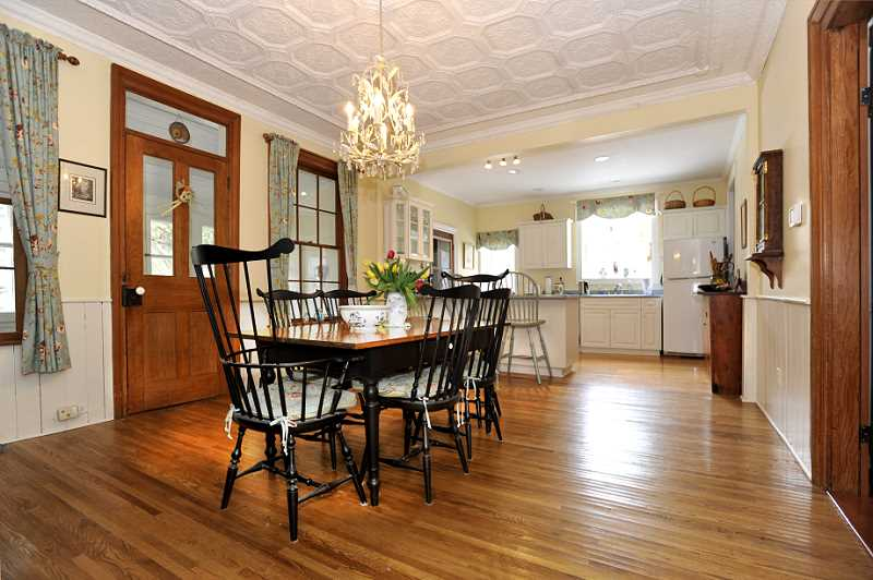 wainscoting, oak strip floors, original tin ceiling, kitchen