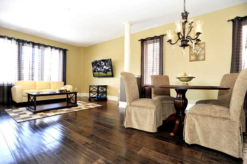 Living & Dining Rooms combined w/ 9 ft. ceilings, high baseboards, hardwood flooring.