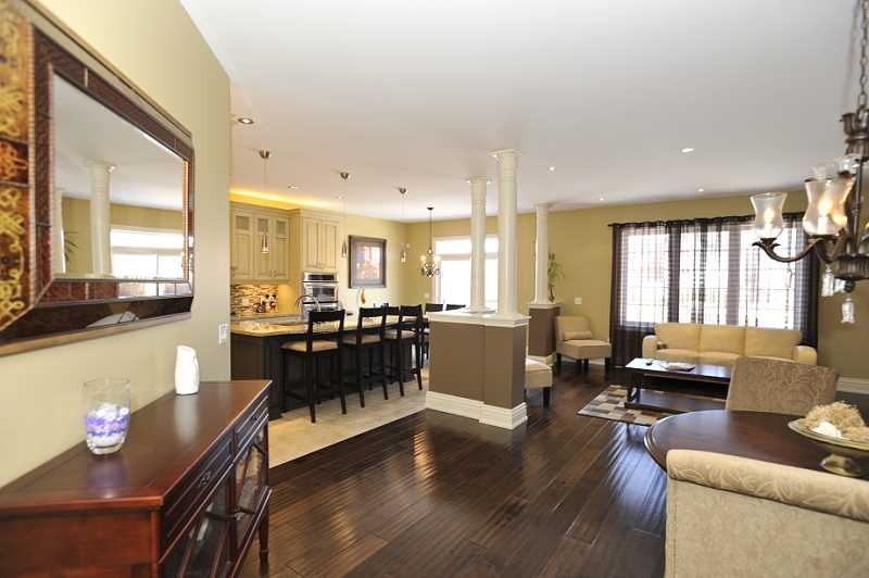 9 ft. ceilings, high baseboards and hardwood flooring.