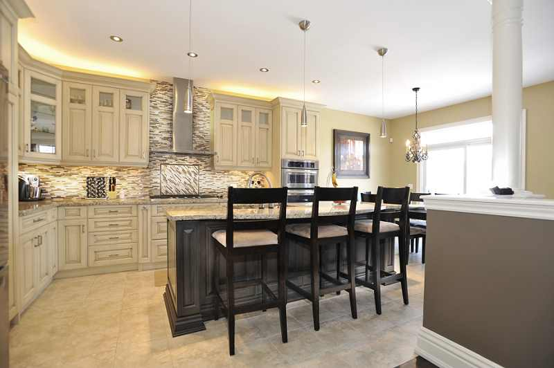 high-end Kitchen has antique maple finished cabinetry
