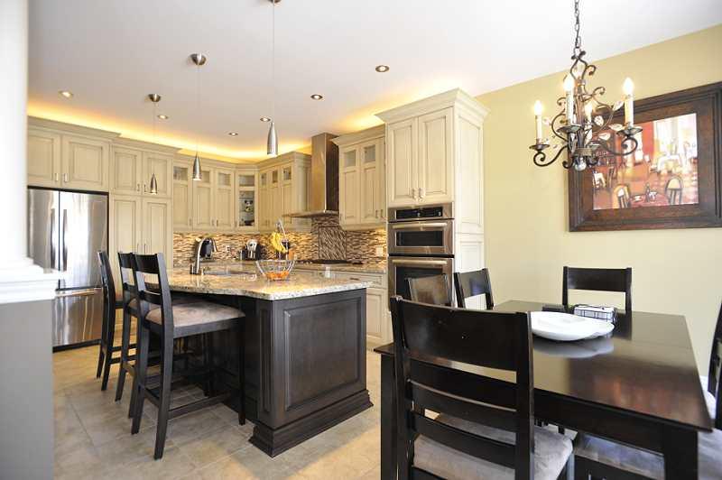 under-counter lighting, glass tile backsplash, pull out pantry