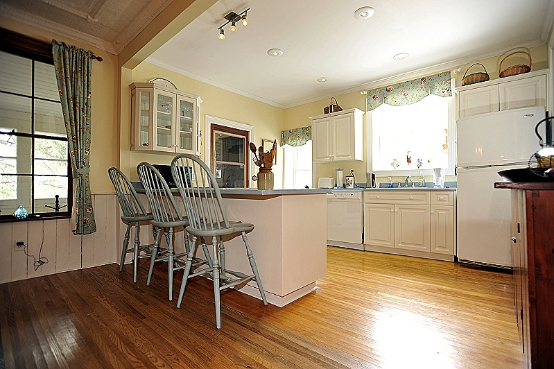 oak strip flooring, wainscoting and original tin ceiling