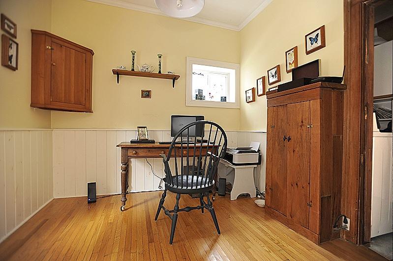wainscoting, oak flooring, office