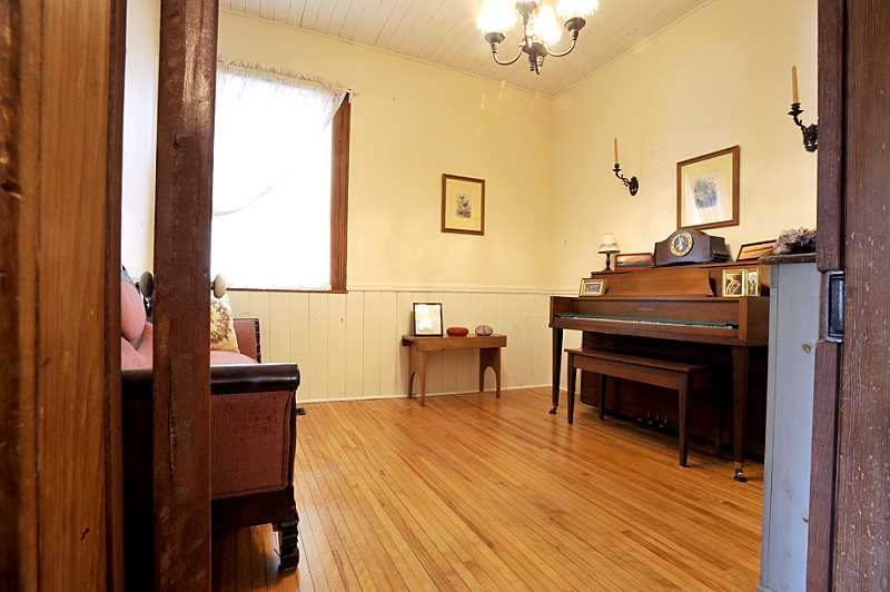 Office Area and Music Room, wainscoting, two original esconse, oak flooring.