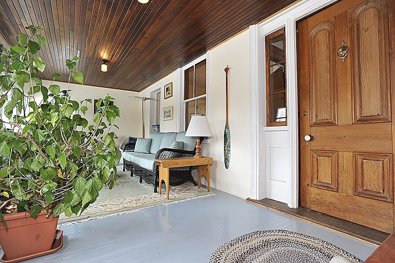 porch, wood floors, custom windows,