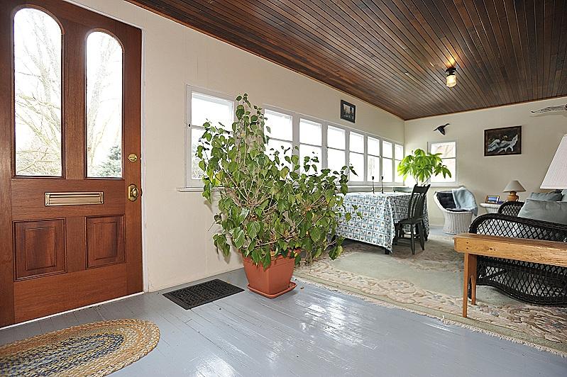 sunny, enclosed porch, wood floors, custom windows