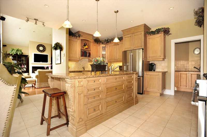 centre island with produce sink, ceramic backsplash, heated floor