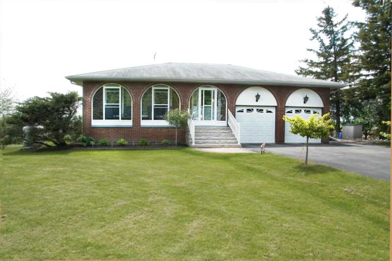 enclosed front porch, landscaped, half acre, caledon