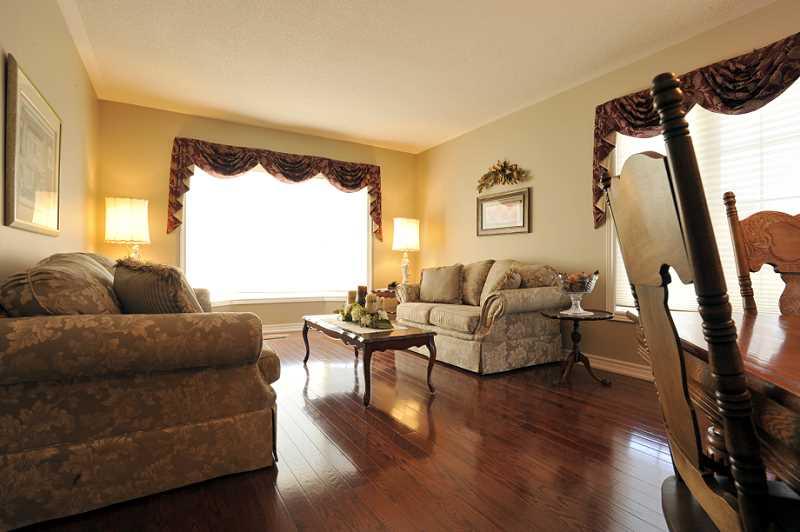 large windows, hardwood floors
