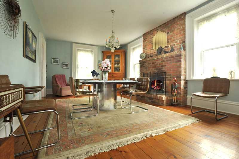 pine plank floors, wood-burning brick fireplace