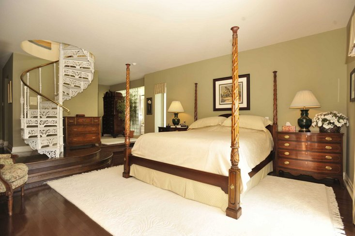 Master bedroom, main floor, hardwood, spiral staircase