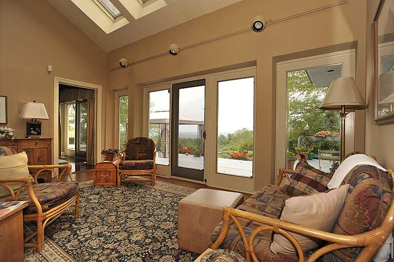 Sun Room has skylights, hardwood flooring