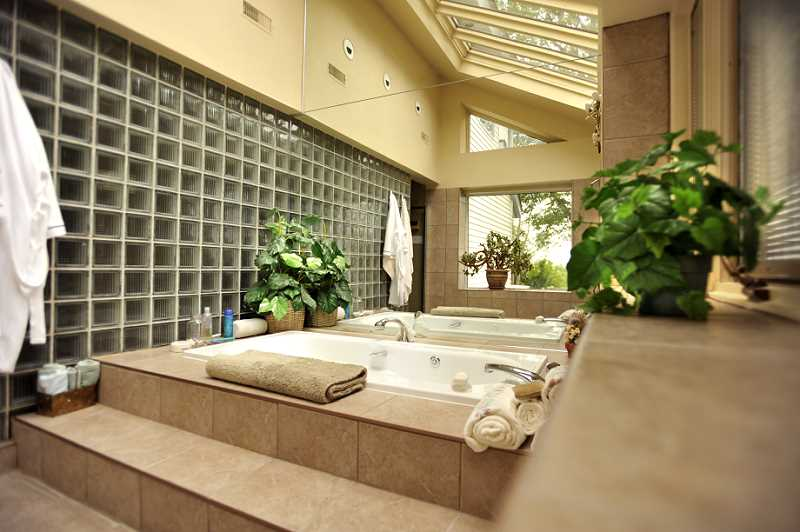 separate Jacuzzi room, light blocks, skylights, ceramic flooring