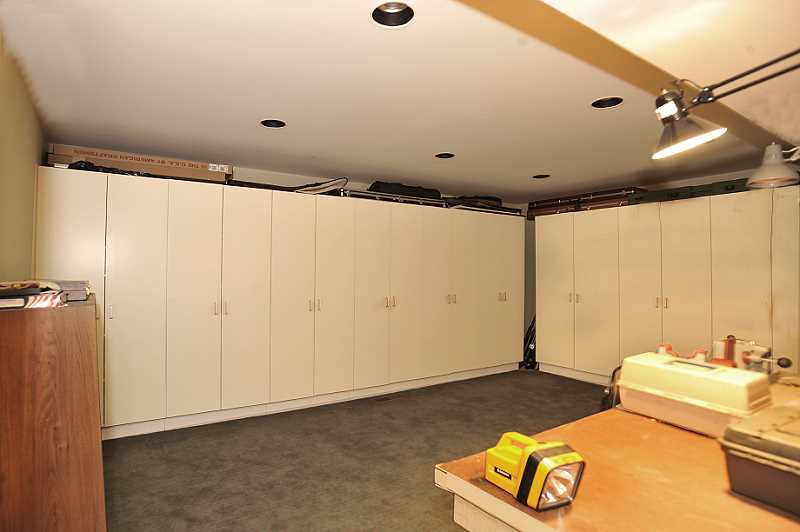 large Storage Room with 10 double-door built-in cupboards