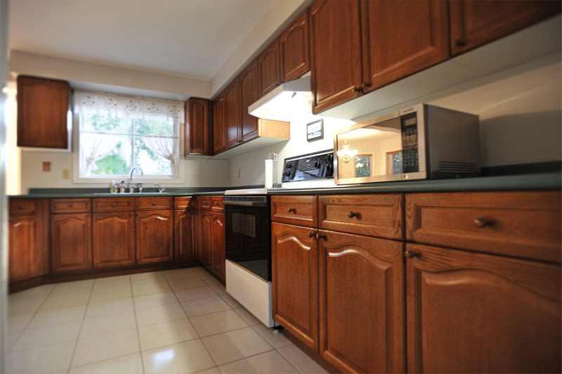 oak Kitchen,  ceramic flooring, walk-out