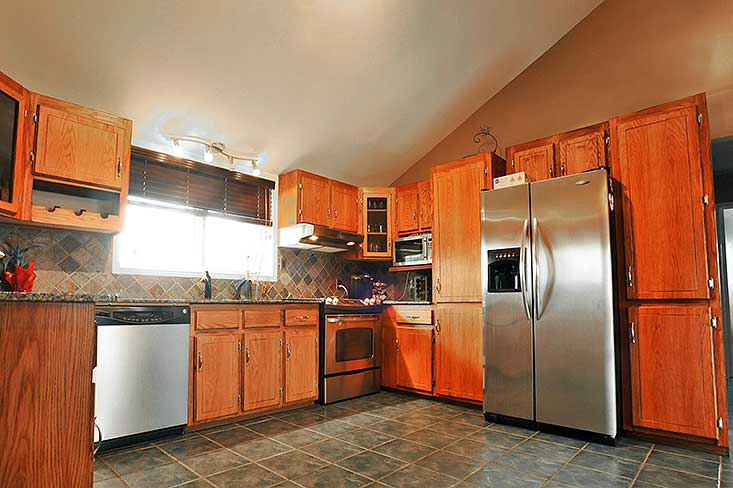 Stainless steel appliances, Oak Kitchen