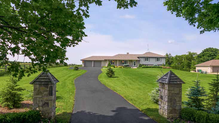 Stone Pillars, Entry, Paved Drive, Double Car Garage